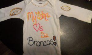 My'isha's longsleeve Broncos onesie.