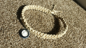 Handmade hemp necklace with black and silver charm