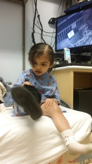 My'isha thinks she is ready to go. Although, she is only going down for scans and she is putting the shoe on the wrong foot.